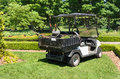 Garden maintenance cart vehicle in park Royalty Free Stock Image