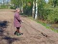 Garden marker woman gardener work with homemade furrow Stock Photography