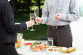 Garden party in the company business with champagne and appetizers Royalty Free Stock Photo