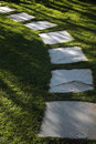 Garden path with beautiful lawn grass made from stone Stock Images