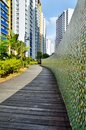 Garden path in city winding between a and mosaic wall with colourful flats singapore Royalty Free Stock Photos