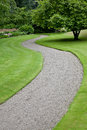 Garden path leading into the distance Royalty Free Stock Photo