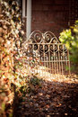 Garden path leading to iron gate secluded wrought Stock Image