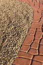 Garden path of red stone and decorative gravel Royalty Free Stock Photos