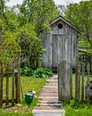 Garden Path With Wooden Outhouse