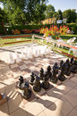 Garden patio with chess game a a board and pieces Stock Images