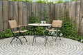 Garden patio with round table and two chairs Royalty Free Stock Photo