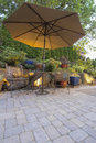 Garden Patio Table and Chairs with Umbrella Royalty Free Stock Photo