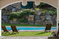 Garden with pool beautiful rocky and wooden beach chair Royalty Free Stock Photography