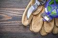 Garden pruner safety gloves soft wire tie on wooden board garden Royalty Free Stock Photo