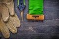 Garden pruner soft wire tie safety gloves on vintage wooden boar Royalty Free Stock Photo
