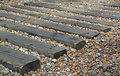 Garden railway sleepers photo of surrounded by beach pebbles Royalty Free Stock Images