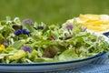 Garden salad with eatable flowers summer Stock Photo