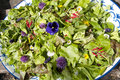 Garden salad with eatable flowers Royalty Free Stock Photo