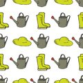 Garden seamless pattern with watering can, rubber boots and hat
