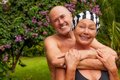 Garden seniors embracing summer hot Royalty Free Stock Image