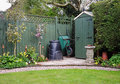 Garden Shed in an English Garden with compost bin Stock Photos