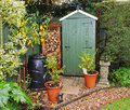 Garden Shed with log store Royalty Free Stock Photo