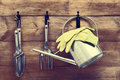 Garden shed tools hanging with watering can on door with vintage feel Royalty Free Stock Photography