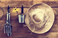 Garden shed tools and straw hat hanging on door with vintage feel Stock Images