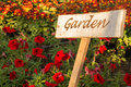 Garden sign on weathered wooden plate Royalty Free Stock Image