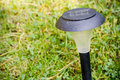 Garden solar lamp eco on in the grass on the Stock Photo