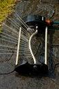 Garden sprinkler detail splash of water from irrigation running water in the Stock Photos