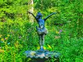 Garden statue child delighted Royalty Free Stock Photo