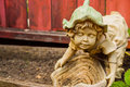 Garden statue old in planter Royalty Free Stock Image