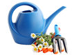 Garden still life watering can flowers white background Royalty Free Stock Photos