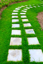 Garden stone foot path with grass Royalty Free Stock Photo