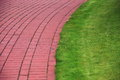 Garden stone path with grass, Brick Sidewalk Royalty Free Stock Photos