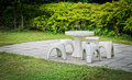 Garden stone table white and chair in the Stock Images