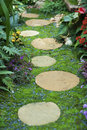 Garden stone walkway winding in Royalty Free Stock Photo