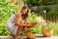 Garden in summer – happy woman with flowers Royalty Free Stock Photography