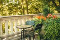 Garden table and chairs on the beautiful terrace Royalty Free Stock Photo
