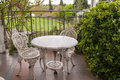 Garden table and chairs with two on a patio Royalty Free Stock Image