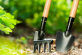 Garden tools on grass background Royalty Free Stock Photo