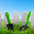 Garden tools on a green lawn background of blue sky Royalty Free Stock Image