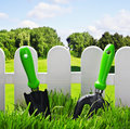 Garden tools on the lawn of the house Royalty Free Stock Photo