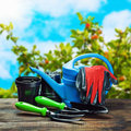 Garden tools lying on a wooden table Royalty Free Stock Photo