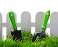 Garden tools near the fence Royalty Free Stock Photos