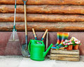 Garden tools photo against wooden wall Royalty Free Stock Photography