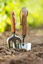 Garden tools stuck in soil Royalty Free Stock Photos