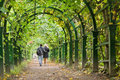 Garden tunnel a couple walking in a Stock Images