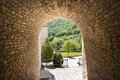 Garden tunnel, light on other side. Royalty Free Stock Photo