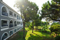 Garden view with trees and hotel in summer resort (Zakynthos, Greece) Royalty Free Stock Image