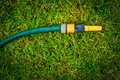 Garden water hose gardening hobby concept with copy space Royalty Free Stock Image