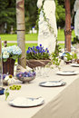 Garden wedding table setting image of for a rustic or dinner party in the Stock Photo
