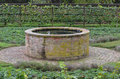Garden well an old in the middle of a Royalty Free Stock Photography